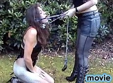 Blonde slut Helga takes her tranny slave out for a walk